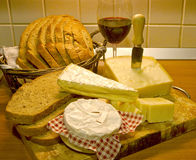 Bread wine and cheese. Slices of fresh bread with a glass of wine and cheese behind Stock Image