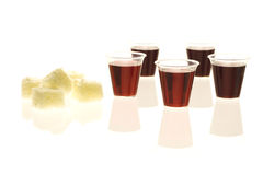 Bread and wine communion cups isolated. Multiple communion cups with wine and bread on isolated background Stock Photos