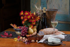 Bread, wine, fruit, cheese still life Stock Images