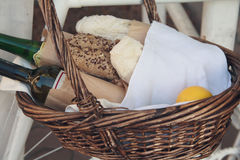 Bread, wine and lemon in a wicker basket Royalty Free Stock Photo