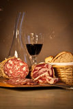 Bread, wine and salami. Still life of Italian cured meat, home-made bread and red wine Stock Image