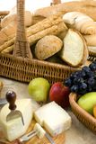 Bread and Wine Series with fruit. An assortment of breads with a glass of red wine and fruit Royalty Free Stock Photo