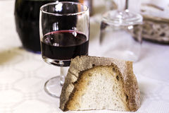 Bread and wine on the table Stock Image