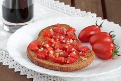 Bread, wine and tomatoes Stock Image