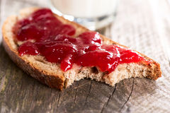 Bread With Strawberry Jam Bited Royalty Free Stock Photography
