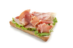 Bread withprosciutto and vegetables. A bread withprosciutto and vegetables stock photo