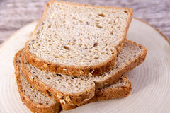 Bread and wood background. Bread Food Concept and Decoration royalty free stock image