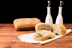 Bread on wood table with oil and vinegar Royalty Free Stock Photography