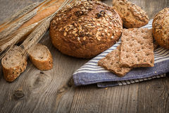 Bread on a wooden background Stock Photography
