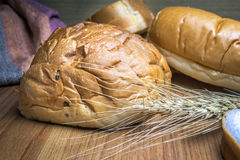 Bread on wooden background Stock Photos