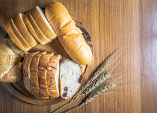 Bread on wooden background Royalty Free Stock Images