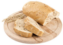 Bread on wooden board, isolated. On white background Royalty Free Stock Photography