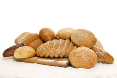 Bread on a wooden board sprinkled with flour Royalty Free Stock Photography