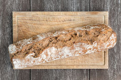 Bread on wooden board and table Royalty Free Stock Image