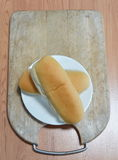 Bread on wooden chop plate Royalty Free Stock Image