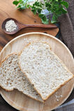 Bread on wooden plate with oat Stock Photos