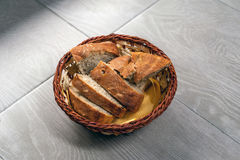 Bread in the wooden pot Stock Images