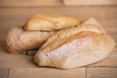 Bread on wooden table Stock Images