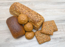 Bread on the wooden table closeup Royalty Free Stock Photos