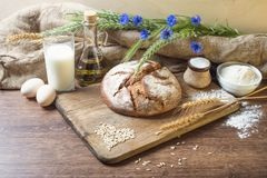 Bread on wooden table Stock Image