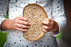 Bread for the world. Childrens hand holding a slice of bread Stock Photography