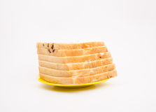 Bread on the yellow plate, in front of the white background Royalty Free Stock Photos