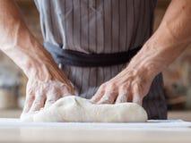 Breadbaking food cooking man hands knead dough stock photo