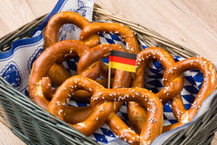 Breadbasket with traditional Bavarian pretzels with German flag.  royalty free stock image