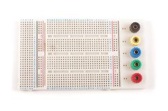 Empty breadboard for electronics prototyping on the whi stock images