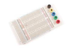Empty breadboard for electronics prototyping isolated on the whi. Breadboard for solderless electronics prototyping and testing new schematics Stock Photos