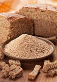 Breadcrumb with black bread. Breadcrumb in brown plate with black bread Stock Image