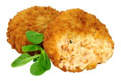 Salmon Fish Cakes. Breadcrumb covered salmon fish cakes isolated on a white background Royalty Free Stock Photo