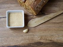 Breadcrumb in a white recipe. With bread on wood backgroud Stock Images