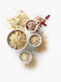 Breadcrumbs. Four different breadcrumbs in porcelain dishes on white table Stock Image