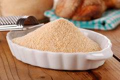 Breadcrumbs in white bowl. On wooden table Stock Photos