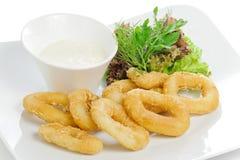 Breaded calamari rings deep fried Stock Photo