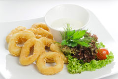 Breaded calamari rings deep fried Royalty Free Stock Image