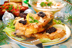 Breaded carp with almonds and prune for christmas. Breaded carp fillets with almonds and prune for christmas Stock Photos