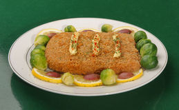 Breaded cheese. On plate with vegetables Royalty Free Stock Images