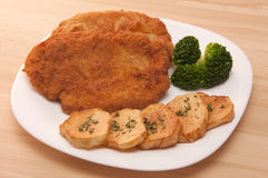 Breaded chicken. Fillet with potatoes and broccoli Stock Images