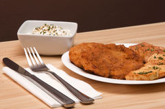 Breaded chicken. Fillet with potatoes and cheese sesame salad Stock Photography