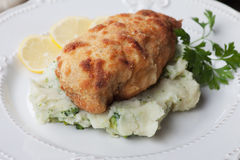 Breaded chicken breast. Served with mashed potato Stock Images