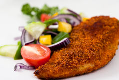 Breaded chicken breast with vegetables royalty free stock image