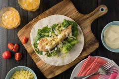 Breaded Chicken burrito Wrap With Fresh Lettuce Cheese. On rustic background Royalty Free Stock Photography
