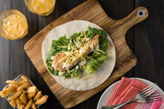 Breaded Chicken burrito Wrap With Fresh Lettuce Cheese. On rustic background Stock Images