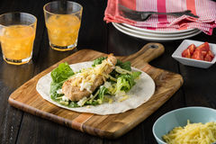 Breaded Chicken burrito Wrap With Fresh Lettuce Cheese. On rustic background Royalty Free Stock Photos