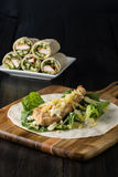 Breaded Chicken burrito Wrap With Fresh Lettuce Cheese. On rustic background Royalty Free Stock Image