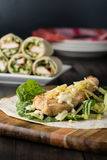 Breaded Chicken burrito Wrap With Fresh Lettuce Cheese. On rustic background Stock Photo