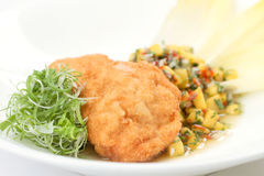 Breaded chicken chop with mango salsa Royalty Free Stock Image