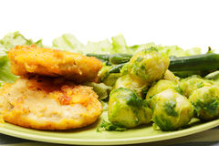 Breaded chicken cutlets with brussels sprouts Stock Image